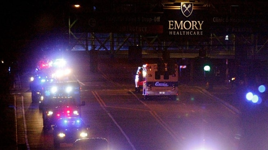 An ambulance transporting Amber Joy Vinson, a U.S. nurse who has Ebola, arrives with a security detail at Emory University Hospital in Atlanta, Georgia October 15, 2014. Vinson, the second Texas nurse who had contracted Ebola, was sent to Emory on Wednesday after being transferred from Texas Presbyterian Hospital. She had treated Liberian patient Thomas Eric Duncan, who died of Ebola and was the first patient diagnosed with the virus in the United States.