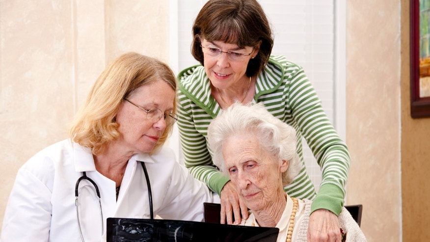 Senior woman visiting with her doctor or caregiver