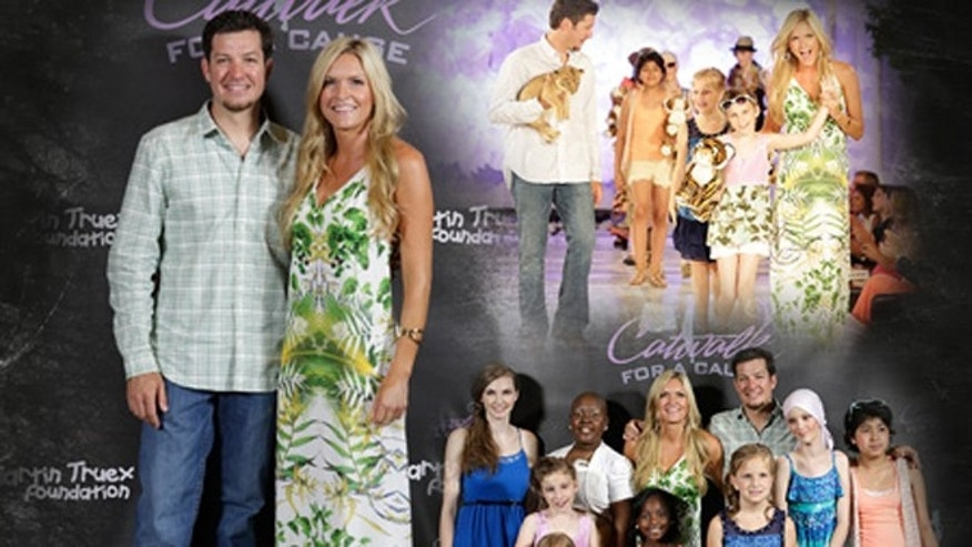 In a photograph released by The Martin Truex Jr. Foundation, Sherry Pollex and Truex are pictured at an event Pollex created called Catwalk for a Cause.