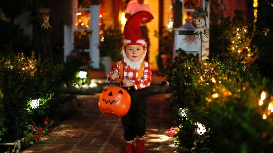 Oct. 31, 2012: A boy collects candy as he goes trick-or-treating for Halloween in Santa Monica, California.