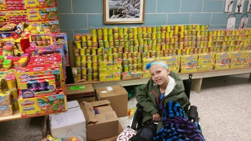 Nevaeh Griffin pictured with Play Doh donated as part of her campaign to give back to other children fighting cancer.