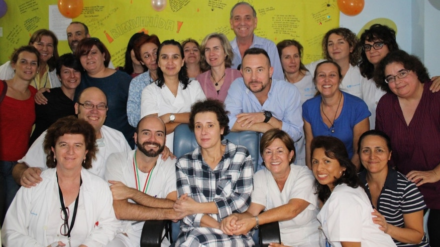 This Nov. 1, 2014 photo provided by the Madridâs Carlos III hospital shows Teresa Romero, center, posing for a photo with medical workers and friends after leaving the isolation unit in the Carlos III hospital in Madrid, Spain. Hospital officials say a Spanish nursing assistant who recovered from an Ebola virus infection has left the isolation unit where she was being monitored and moved to a normal room. Teresa Romero tested positive on Oct 6, but was declared cured of the virus 15 days later. She was the first known person to contract the disease outside of West Africa in the latest outbreak. Madridâs Carlos III hospital said Saturday that Romero, 44, was now being attended by hospital staff that no longer needed to wear protective outfits. (AP Photo)