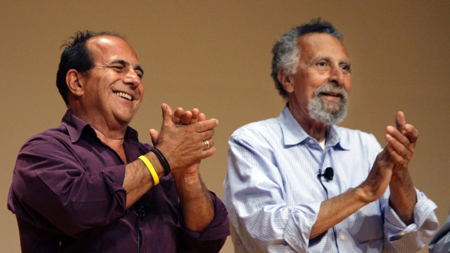 "June 19, 2008: In this photo, brothers Ray, left, and Tom Magliozzi, co-hosts of National Public Radio's ""Car Talk"" show, applaud during a premier of a cartoon show about them in Cambridge, Mass."