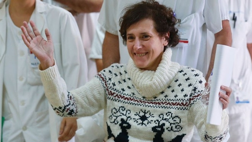 Spanish nurse Teresa Romero who contracted Ebola raises her arms after being discharged from the Carlos III hospital in Madrid, November 5, 2014.