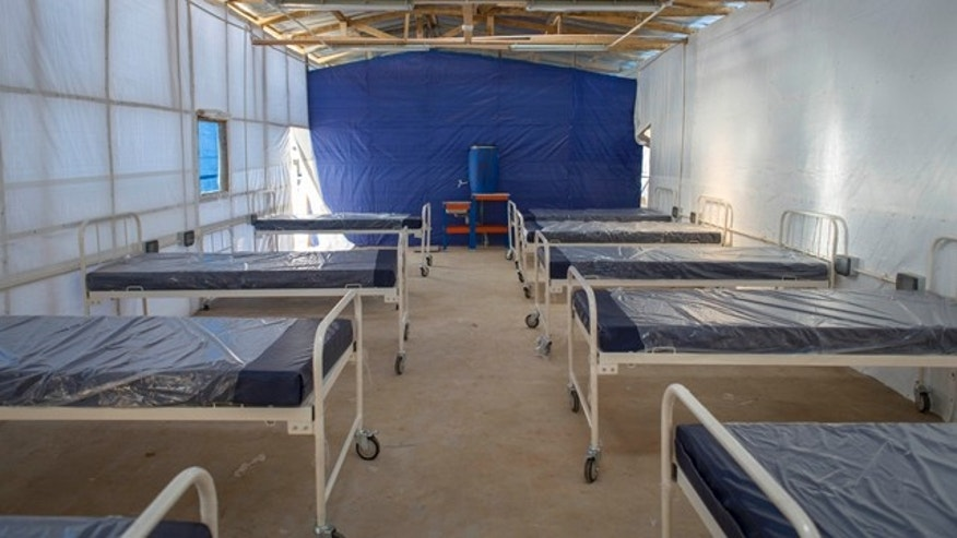 November 5, 2014: This undated handout photo issued by Save the Children UK shows equipment still wrapped in plastic inside what will be the red zone of the Kerry Town Ebola Treatment Centre in Sierra Leone. (AP Photo, Louis Leeson/Save the Children UK)