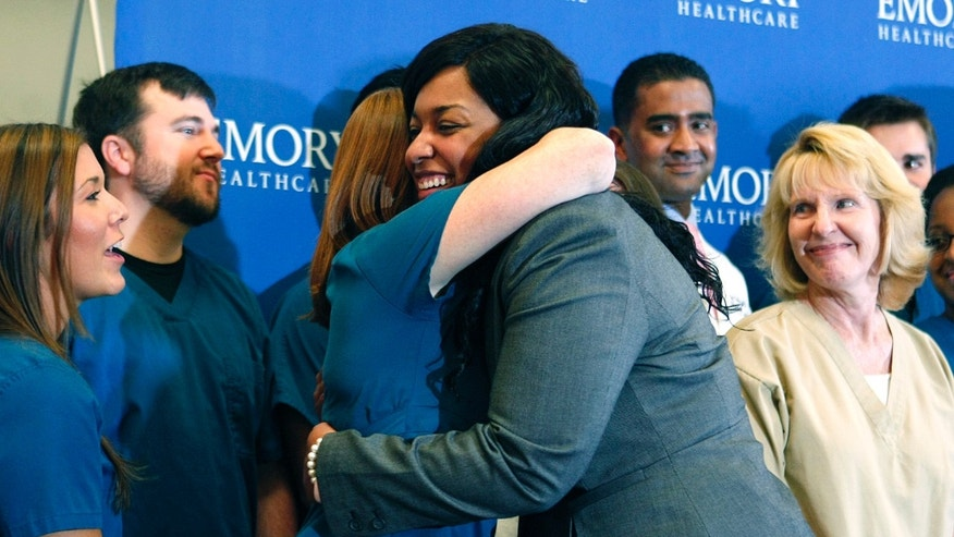 Amber Vinson hugs caregivers before her release from Emory University Hospital in Atlanta, Georgia October 28, 2014. REUTERS/Tami Chappell