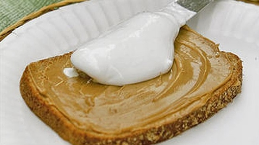 Ingredients of a Fluffernutter sandwich -- Marshmallow Fluff, peanut butter and bread -- are shown in Marlborough, Mass., Tuesday, June 20, 2006. The beloved New England sandwich now finds itself at the center of a sticky political debate at the Massachusetts Statehouse. (AP Photo/Bill Sikes)