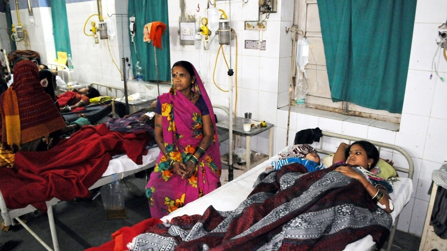 Indian women who underwent sterilization surgeries receive treatment at the CIMS hospital in Bilaspur, in the central Indian state of Chhattisgarh, Tuesday, Nov. 11, 2014 (AP Photo)