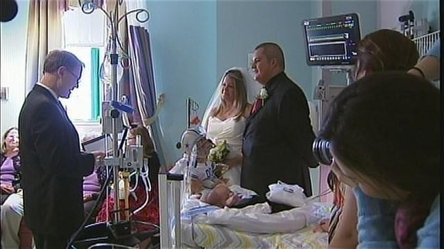 J.J. Nelson's parents, Kristi and Justin, wed at his bedside.