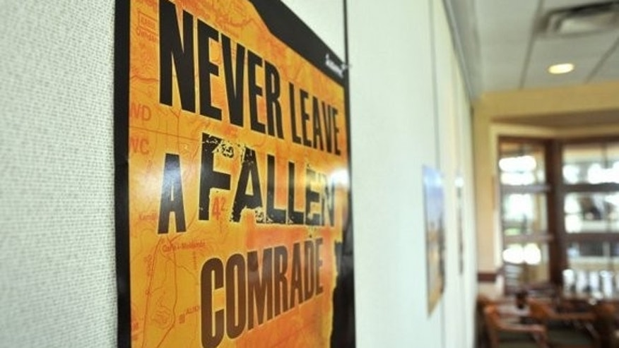 A suicide prevention poster tacked to the wall at Fort Bragg, N.C.
