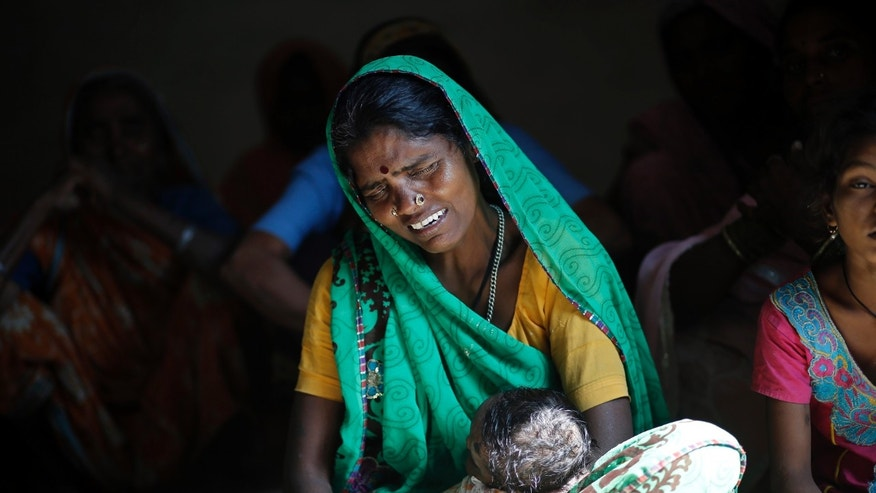 Indra Bai, the mother of a deceased victim who died after she underwent a sterilization surgery at a government mass sterilisation camp, holds a child as she mourns in her house at Bilaspur district in the eastern Indian state of Chhattisgarh November 14, 2014. REUTERS/Anindito Mukherjee