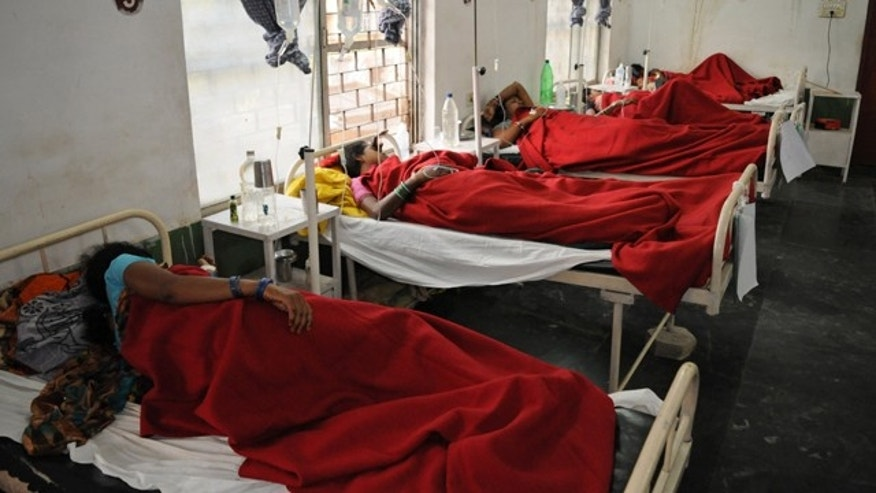 November 12, 2014: Indian women who underwent sterilization surgeries receive treatment at the District Hospital in Bilaspur, in the central Indian state of Chhattisgarh, after at least a dozen died and many others fell ill following similar surgery. (AP Photo)