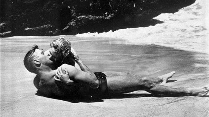 "Burt Lancaster kisses Deborah Kerr passionately in a beach scene in the 1953 film ""From Here To Eternity."" The two shared one of cinema's most famous kisses .. and bacteria, most likely."