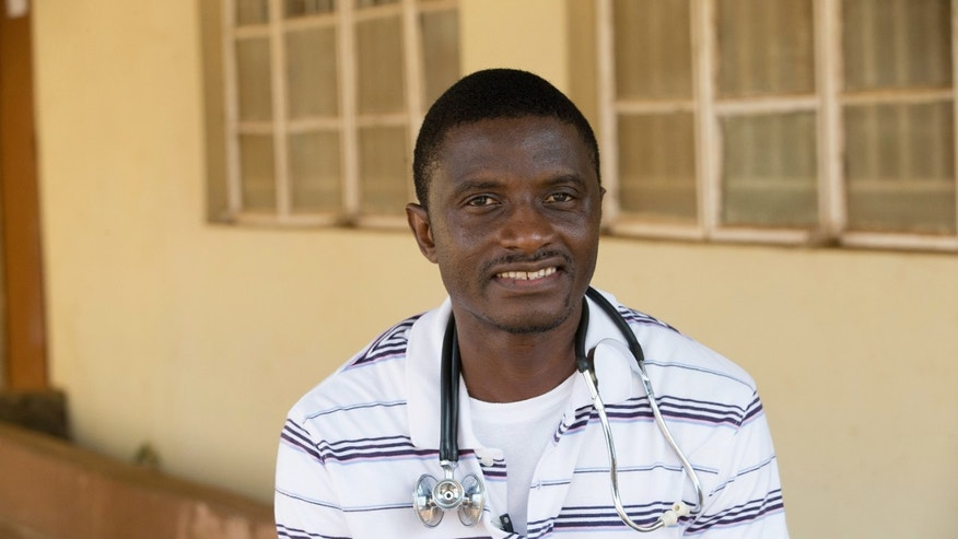 In this April 2014, file photo, provided by the United Methodist News Service, Dr. Martin Salia poses for a photo at the United Methodist Church's Kissy Hospital outside Freetown, Sierra Leone.