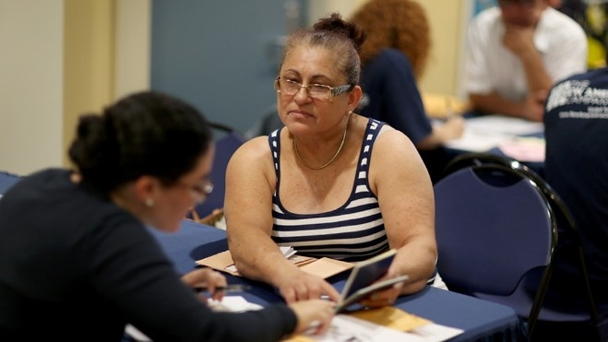 MIAMI, FL - SEPTEMBER 13:  Gloria Lopez, originally from Nicaragua, sits with Jaclyn O'Connor, a Florida International University law school graduate, as she receives help in applying for United States citizenship September 13, 2014 in Miami, Florida. The clinic put on by the Florida New Americans (FNA) program, an initiative of the Florida Immigrant Coalition, provides legal assistance, study materials and information to Floridians applying for U.S. citizenship. Today, the program partnered with the Florida International University and Catholic Legal Services of the Archdiocese of Miami, to assist current eligible green-card holders with their citizenship application.  (Photo by Joe Raedle/Getty Images)