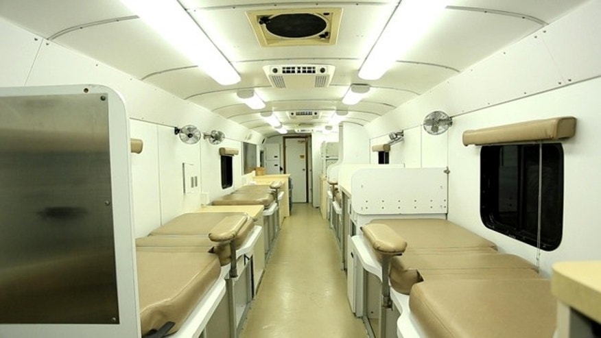 November 7, 2014: This photo shows the inside a mobile donation unit at the Raleigh-Durham International Airport in Raleigh, N.C. The unit was headed to Africa for use in a study of blood plasma treatment for Ebola patients. (AP Photo/Trevor Jenkins)