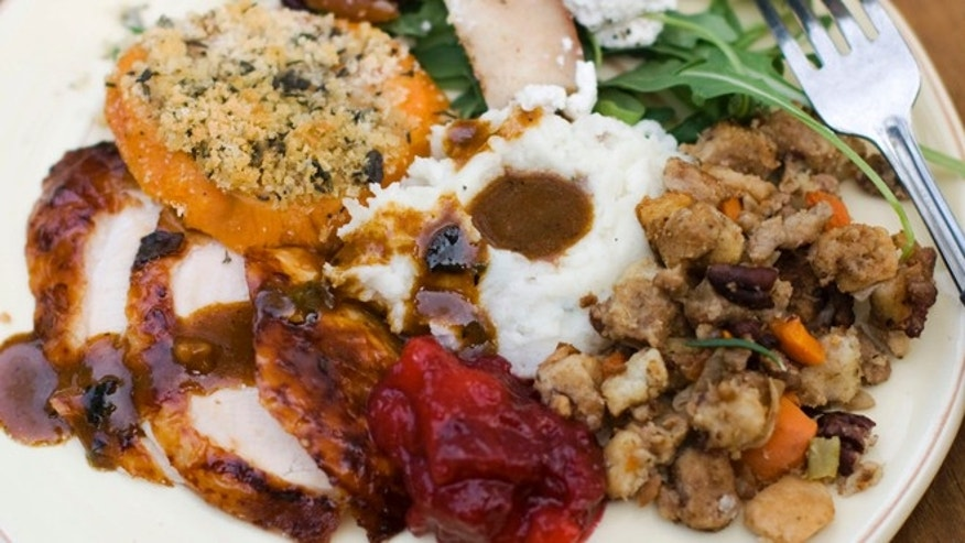 Oct. 8, 2012: A Thanksgiving dinner plate of cider brined turkey with sage gravy, peach cranberry sauce, sour cream and chive mashed potatoes, sausage pecan stuffing, arugula pear salad with pomegranate vinaigrette and goat cheese and herb crusted sweet potatoes.