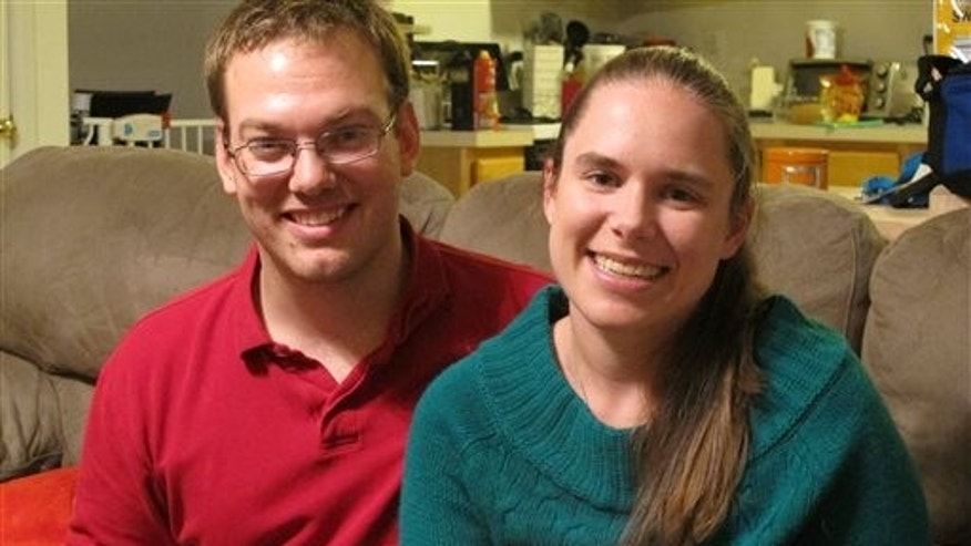 Nov. 25: Alyssa Riggan, who was the first in the United States to successfully receive a liver from a living donor 25 years ago, poses with her husband, Benjamin, in their home in Severn, Md.
