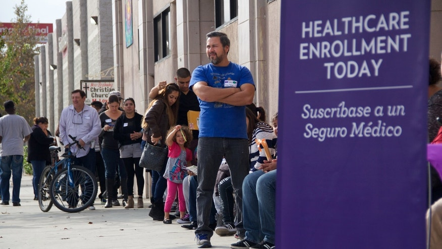 This photo provided by the Service Employees International Union shows people waiting to enter an Affordable Care Act enrollment event sponsored by SEIU-United Healthcare Workers West and Community Coalition, in Los Angeles Saturday, Nov. 15, 2014. California's health care exchange is targeting Latinos and others who missed last year's first enrollment season under the Affordable Care Act. While the process left consumers and insurers frustrated at times, the sign-ups in California were generally seen as more successful than in other states that opted to run their own insurance marketplaces. (AP Photo/SEIU, Michael Chavez)