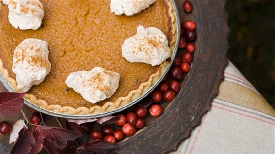 In this image taken on Oct. 8, 2012, a maple pumpkin pie with cinnamon-maple whipped cream is shown in Concord, N.H. (AP Photo/Matthew Mead)