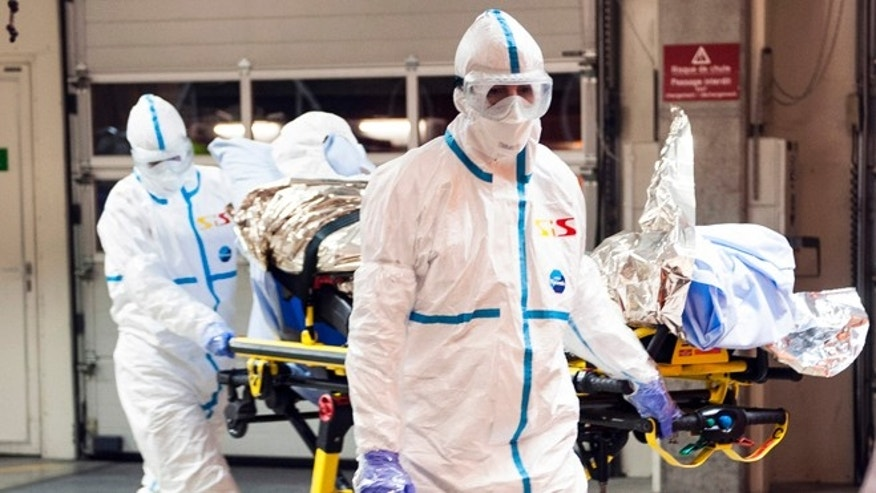 In this photo provided by the Geneva University Hospital (HUG), Cuban doctor Felix Baez Sarria, who contracted Ebola in Sierra Leone, arrives on a gurney at the Geneva University Hospital in Geneva, Switzerland, Friday, Nov. 21, 2014. Baez, a member of the 165-person medical team Cuba sent to Sierra Leone to help with the Ebola outbreak, caught the disease when he rushed to help a patient who was falling over. (AP Photo/Julien Gregorio, Geneva University Hospital) MANDATORY CREDIT, NO ARCHIVE