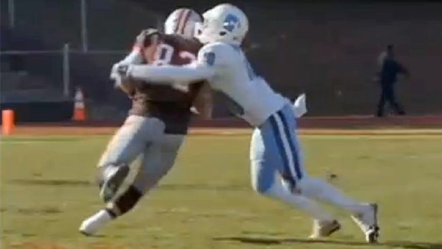This undated photo shows an unidentified Columbia football player tackling an opponent.