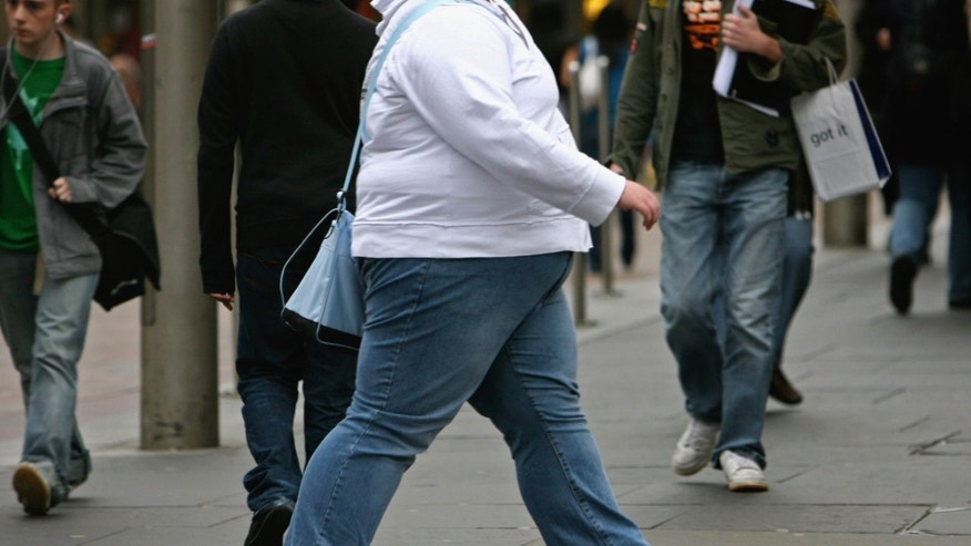 "GLASGOW, UNITED KINGDOM - OCTOBER 10:  An overweight person walks through Glasgow city centre on October 10, 2006 in Glasgow, Scotland. According to government health maps published today, people in the north of England lead less healthy lifestyles compared to those in the south. The United Kingdom is also the fattest country in Europe, according to a new study of obesity rates to be released today. The ""Health Profile of England"" report, compiled from government data, said some 24 percent of people in England, Wales, Scotland and Northern Ireland are obese.  (Photo by Jeff J Mitchell/Getty Images)"