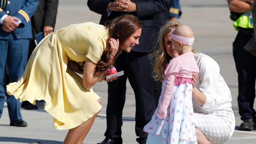 July 7, 2011: Catherine, Duchess of Cambridge, talks to 6-year-old Diamond Marshall as she arrives in Calgary, Alberta with her husband Britain' Prince William.
