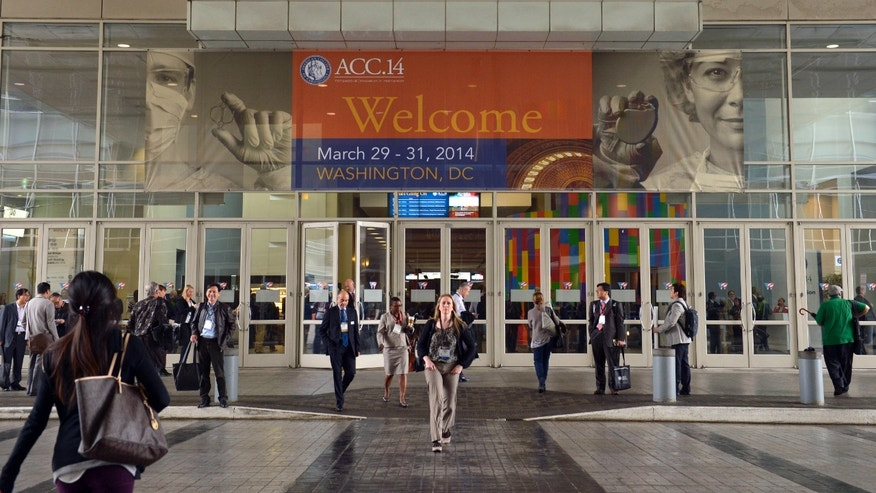 In this March 29, 2014, file photo, people attend the American College of Cardiology's Annual Scientific Session and Expo in Washington. (AP Photo/Susan Walsh, File)