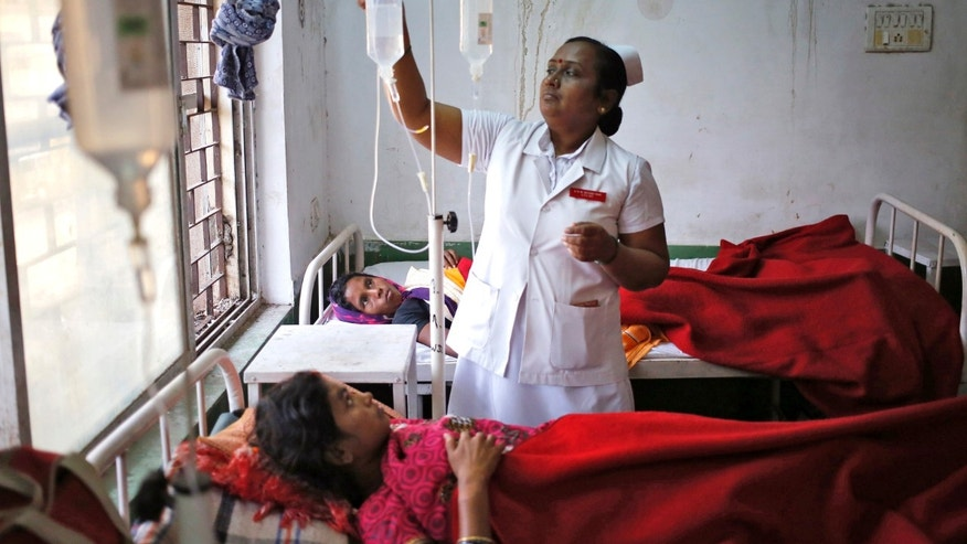 "A nurse tends to a woman, who underwent a sterilization surgery at a government mass sterilization ""camp"" at Chhattisgarh Institute of Medical Sciences (CIMS) hospital in Bilaspur, in the eastern Indian state of Chhattisgarh, November 13, 2014. The doctor whose sterilization of 83 women in less than three hours ended in at least a dozen deaths said the express operations were his moral responsibility and blamed adulterated medicines for the tragedy. REUTERS/Anindito Mukherjee"