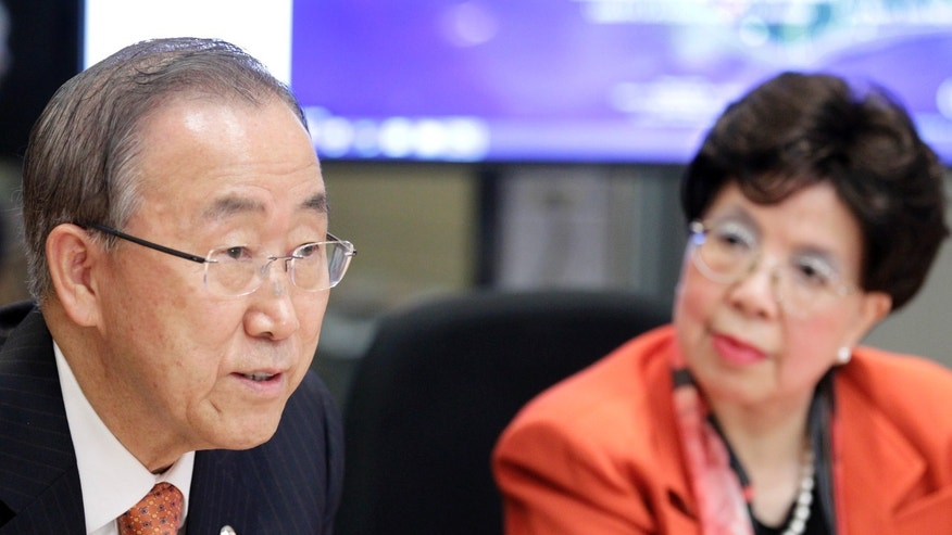 United Nations Secretary-General Ban Ki-moon (L) and World Health Organization(WHO) Director-General Margaret Chan attend a meeting in the WHO Strategic Health Operations Centre (SHOC) room at the WHO headquarters in Geneva October 1, 2014. REUTERS/Pierre Albouy