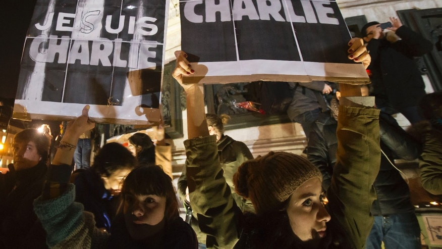 "Jan. 8, 2015: Protestors hold posters which read, ""I am Charlie,"" during a solidarity demonstration in Paris."