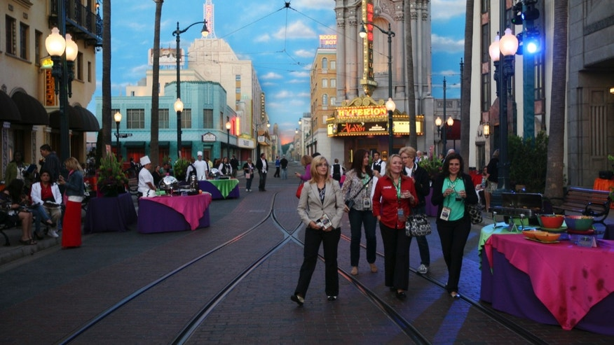 June 14, 2012: People walk on Buena Vista Street, which is based on 1920s Hollywood landmarks, on the eve of the public grand reopening of Disney California Adventure Park in Anaheim, California.
