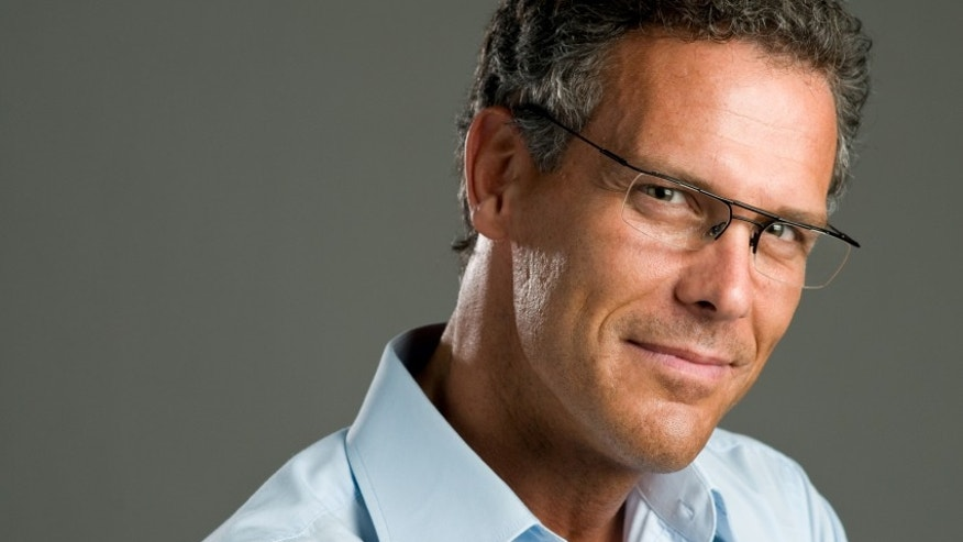 Handsome mature man looking at camera with a pair of modern glasses
