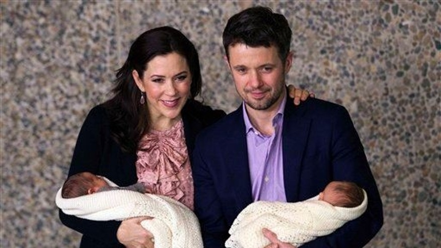 In this Jan. 14, 2011 file photo, Denmark's future monarchs Crown Prince Frederik and Crown Princess Mary present their newborn twins in their first public appearance in Copenhagen.