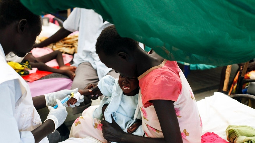 A medical staff attends to a malnourished child at a Medecins Sans Frontieres (MSF) hospital in an internally displaced persons (IDP) camp inside the U.N. base in Malakal, July 24, 2014.  REUTERS/Andreea Campeanu