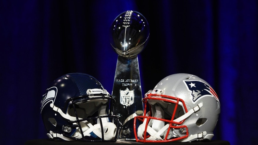 Jan 30, 2015: General view of the Vince Lombardi Trophy and helmets for the Seattle Seahawks and New England Patriots during a press conference for Super Bowl XLIX at Phoenix Convention Center.