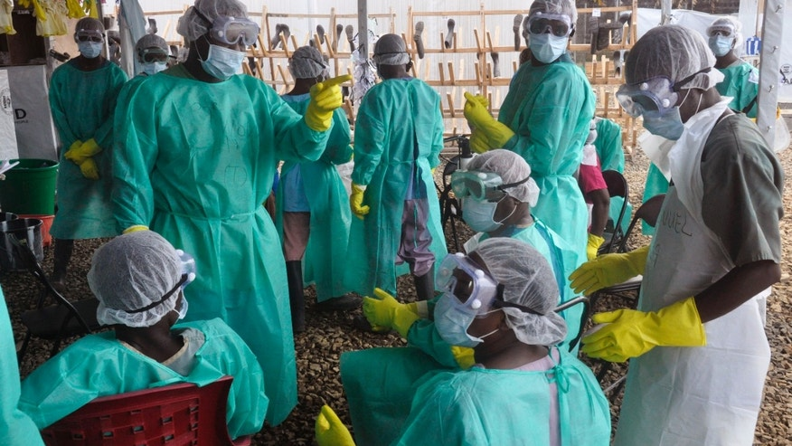 Health care workers inside a USAID,  funded Ebola clinic with their Ebola virus protective gear in Monrovia, Liberia, Friday, Jan. 30, 2015. (AP Photo/ Abbas Dulleh)