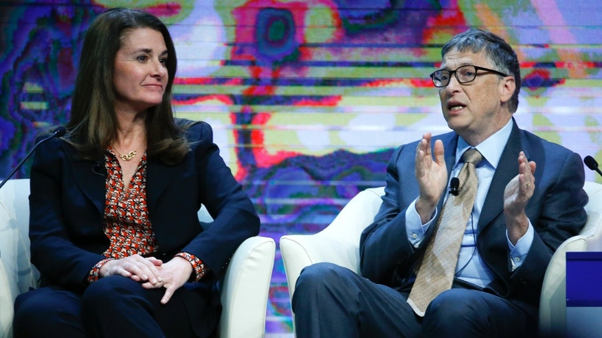 "Bill Gates, Co-Chair of the Bill & Melinda Gates Foundation gestures next to his wife Melinda French Gates during the session ""Sustainable Development: A Vision for the Future"" in the Swiss mountain resort of Davos January 23, 2015. REUTERS/Ruben Sprich"