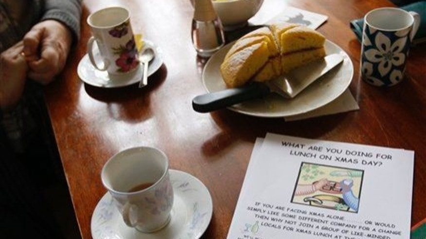 Women have afternoon tea and cake in the Raven Inn village pub in Wales.
