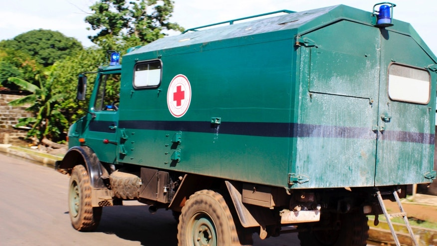 A Red Cross truck carrying the body a woman who died of the Ebola virus drives in the Aberdeen district of Freetown, Sierra Leone, October 14, 2014. REUTERS/Josephus Olu-Mammah