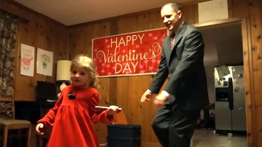 The O'Neill family recreated a school's Frozen-themed Valentine's Day dance for their daughter, Eliza, pictured with father Glenn.