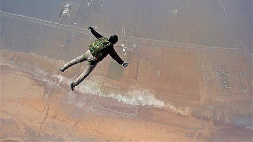 An Iranian skydiver jumps from a helicopter outside Tehran, Iran, Friday, March 7, 2014.