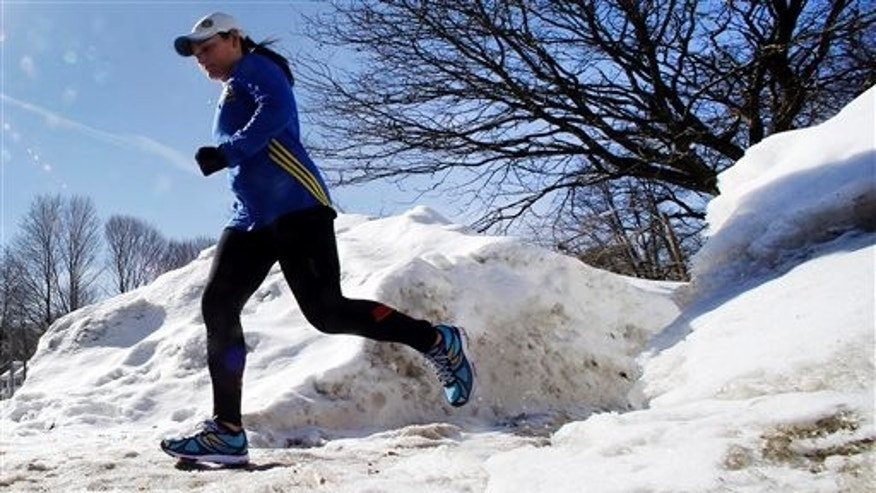 Runner Becca Pizzi, 34, trains along Heartbreak Hill in Newton, Mass., Friday, Feb. 27, 2015. (AP Photo/Elise Amendola)