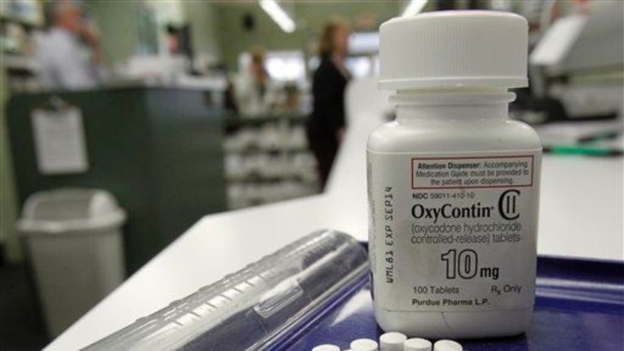 OxyContin pills appear in a photo at a pharmacy in Montpelier, Vt., on Feb. 19, 2013.