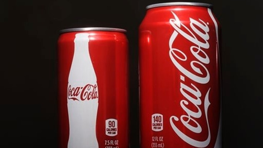 In this Jan. 12, 2015 file photo, a 7.5-ounce can of Coca-cola, left, is posed next to a 12-ounce can for comparison. (AP Photo/Matt Rourke, File)