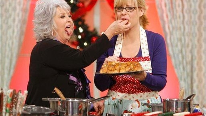 "Bonnie Hunt is fed a piece of monkey bread, a recipe by guest Paula Deen during a taping of ""The Bonnie Hunt Show,"" Dec. 9, 2008, in Culver City, Calif."
