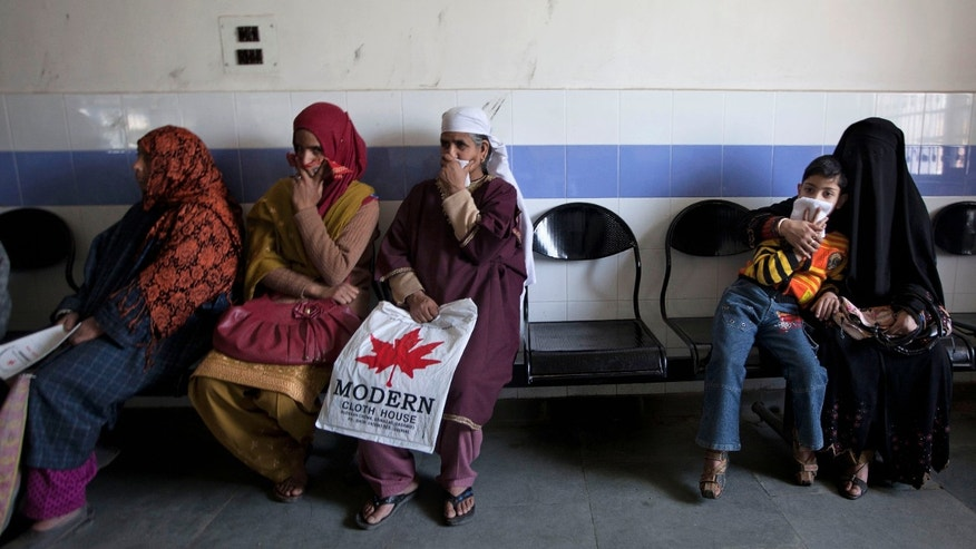 A child waits along with Kashmiri women for his turn to be examined at the Chest Disease Hospital on World Tuberculosis Day in Srinagar, India. Health officials are embarking on an ambitious plan to wipe out tuberculosis in children even though they don't know exactly how many cases there are.