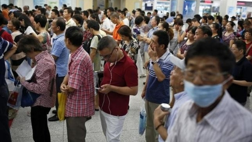 Sept. 2, 2014: People queue at a hospital in Shanghai.