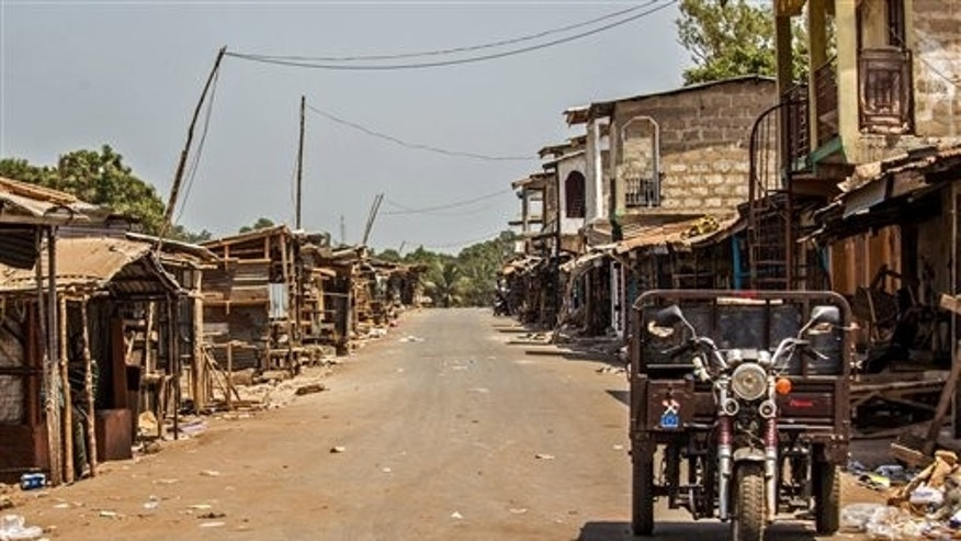 A usually busy market street is deserted as Sierra Leone enters the second day of a three-day country wide lockdown on movement of people due to the Ebola virus in the city of Freetown, Sierra Leone, Saturday, March 28, 2015. (AP Photo/Michael Duff)